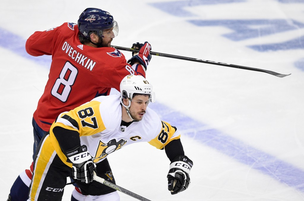 Washington Capitals left wing Alex Ovechkin (8), of Russia, skates against Pittsburgh Penguins center Sidney Crosby (87) during the third period in Ga...