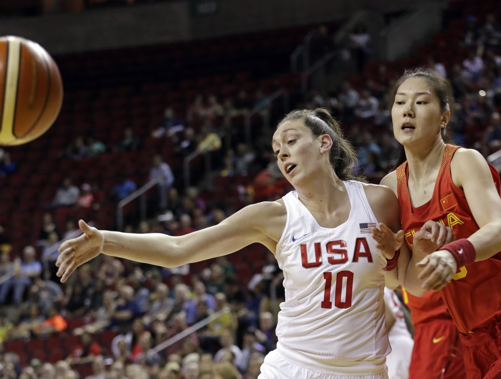United States' Breanna Stewart (10) and China's Mengran Sun eye a loose ball in the first half of an exhibition basketball game Thursday, April 26, 20...
