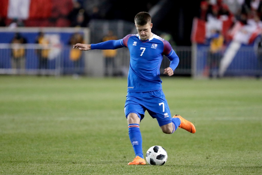 In this photo taken on Tuesday, March 27, 2018, Iceland's Johan Berg Gudmundsson passes the ball against Peru during the second half of an internation...