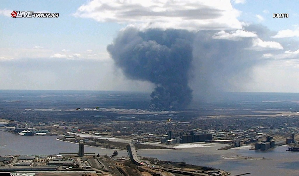 This image from video provided by WDIO-TV in Duluth, Minn., shows smoke rising from the Husky Energy oil refinery after an explosion and fire Thursday...
