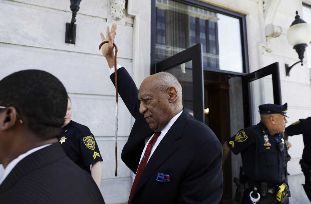 Bill Cosby gestures as he leaves the Montgomery County Courthouse in Norristown, Pa., after being convicted of drugging and molesting a woman, Thursda...