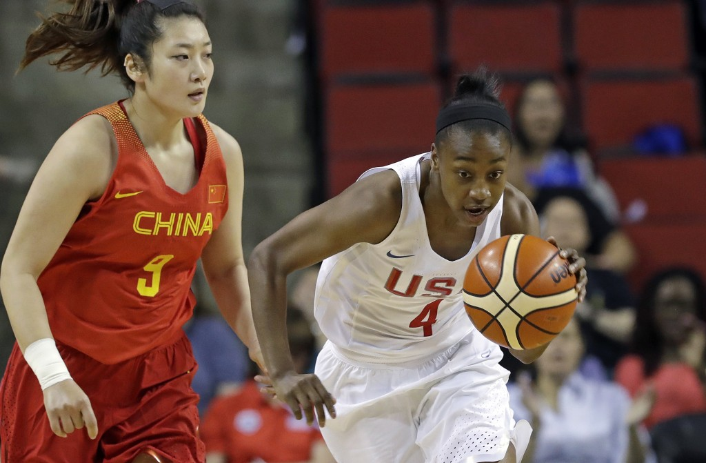 United States' Jewell Loyd (4) races away with the ball after stealing it from China's Meng Li (9) during the first half of an exhibition basketball g...