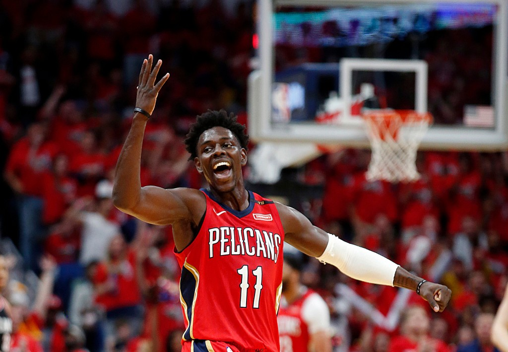 FILE - In this April 21, 2018, file photo, New Orleans Pelicans guard Jrue Holiday gestures during the first half of Game 4 of the team's first-round ...