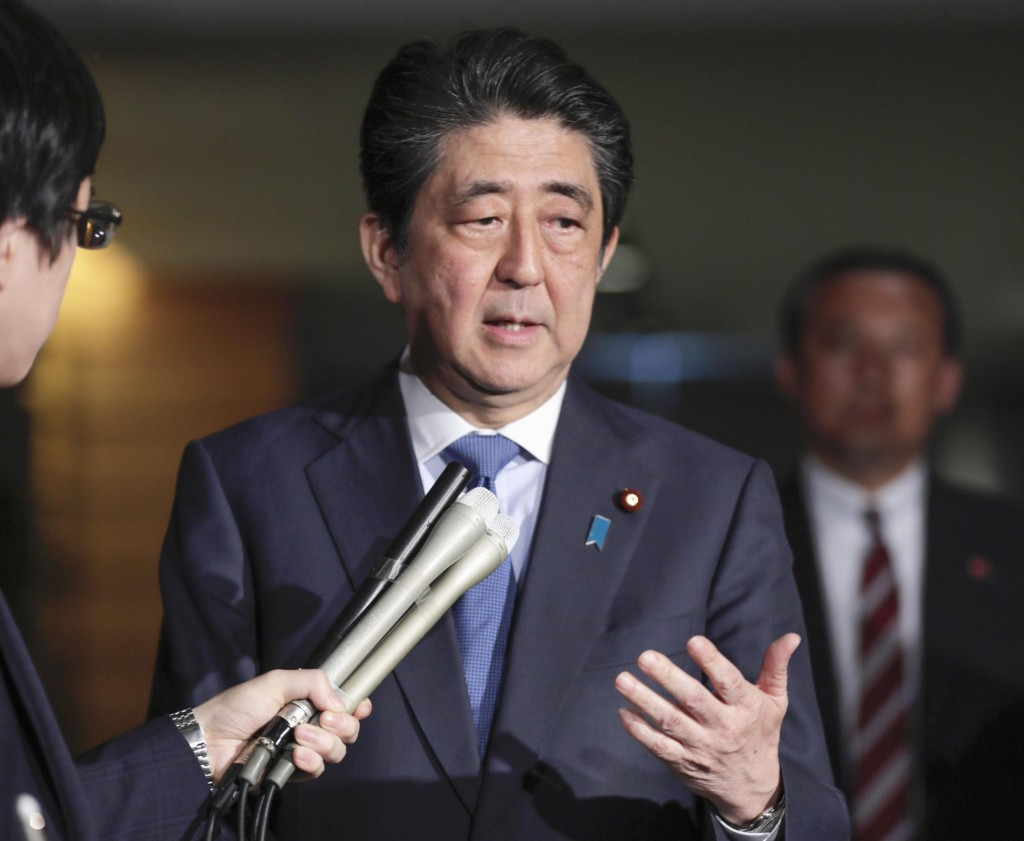 Japanese Prime Minister Shinzo Abe speaks to journalists at at Prime Minister's office Friday, April 27, 2018, in Tokyo. Abe praised the talks Friday ...