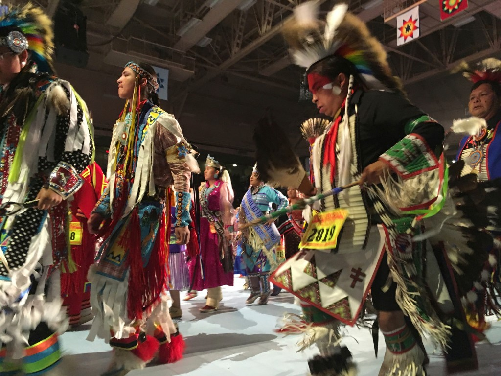 FILE--In this April 28, 2017 file photo, dancers take part in the grand entry to the Gathering of Nations in Albuquerque, N.M. The Gathering of Nation...