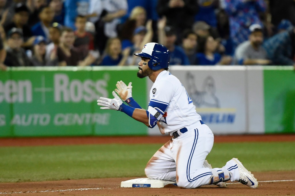 Toronto Blue Jays' Devon Travis reacts after hitting a triple against the Boston Red Sox during the seventh inning of a baseball game in Toronto on Th...