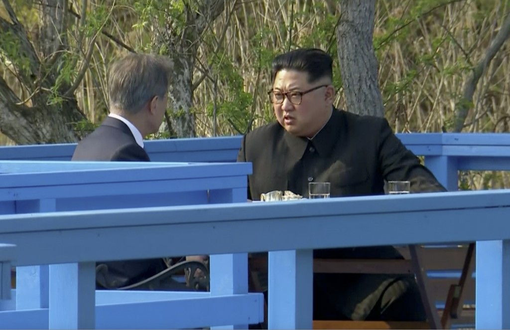 In this image made from video provided by South Korea Host Broadcast, North Korean leader Kim Jong Un, right, and South Korean President Moon Jae-in, ...