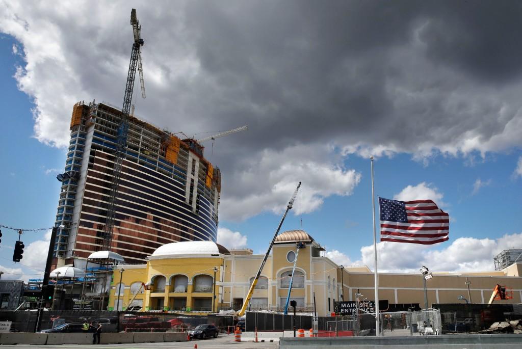 Clouds pass over the Wynn Resorts casino construction site in Everett, Mass., Thursday, April 26, 2018. Massachusetts gambling regulators consider Wyn...