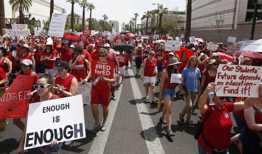 Thousands march in the street to the Arizona Capitol for higher teacher pay and school funding Thursday, April 26, 2018, in Phoenix. The unprecedented...
