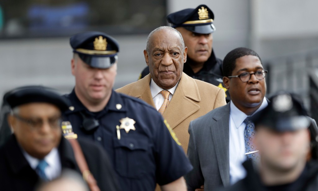 FILE - In this April 12, 2018 file photo, Bill Cosby, center, leaves his sexual assault trial at the Montgomery County Courthouse in Norristown, Pa. O...