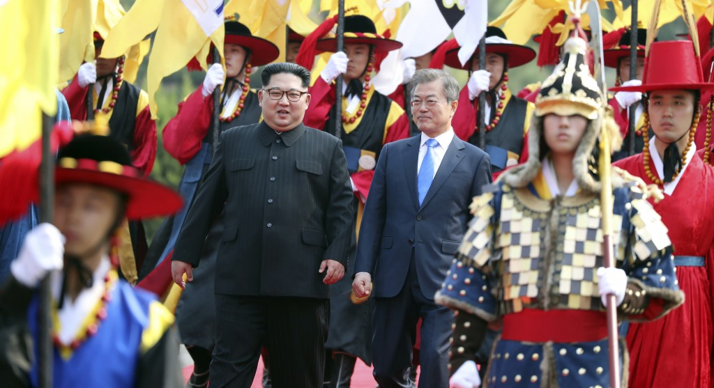 FILE - In this Friday, April 27, 2018, file photo, North Korean leader Kim Jong Un, left, and South Korean President Moon Jae-in, right, walk together...