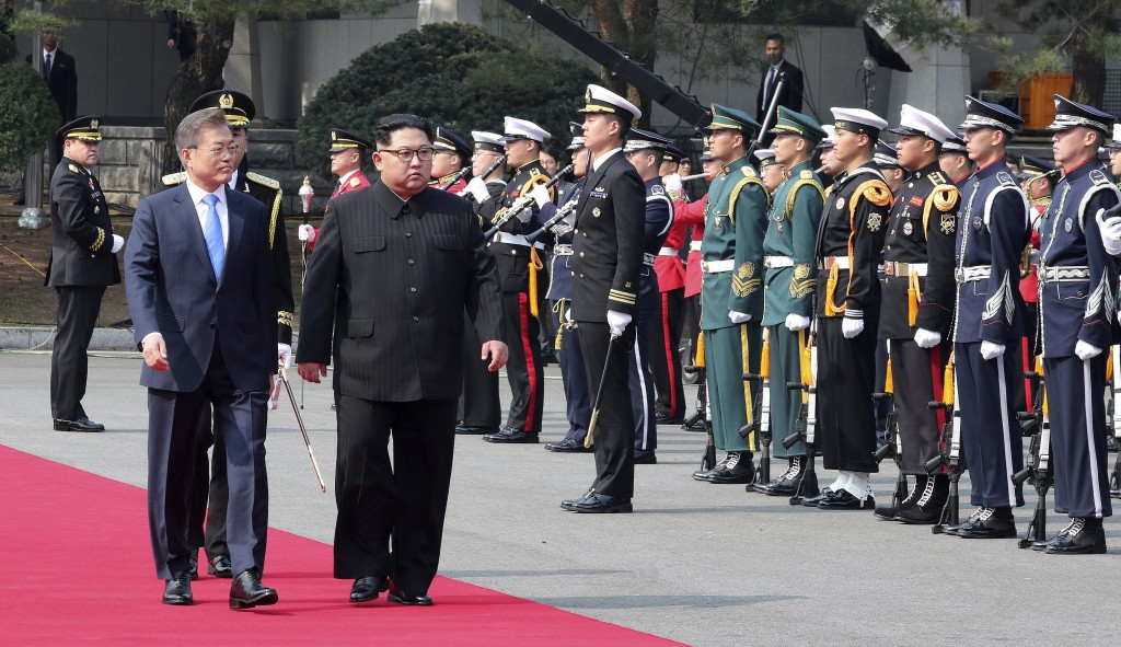 North Korean leader Kim Jong Un, second from left, and South Korean President Moon Jae-in, left, inspect a guard of honor during a welcome ceremony at...
