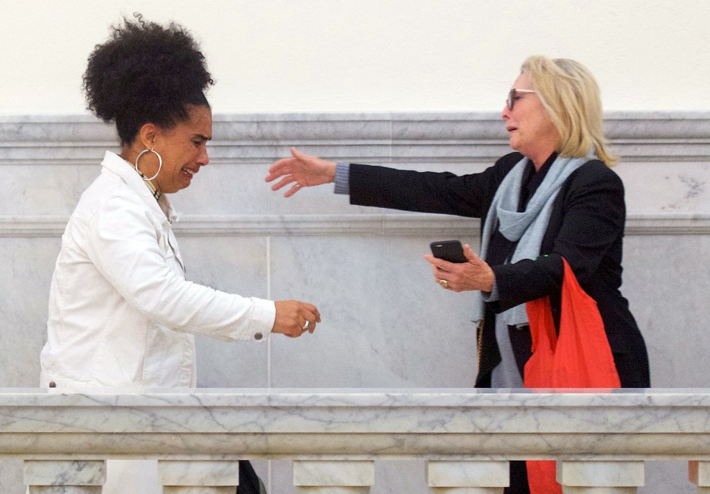 Bill Cosby accusers Lili Bernard, left, and Victoria Valentino, right, reach out to embrace outside the courtroom after Cosby was found guilty in his ...
