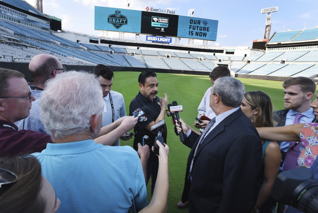 Jacksonville Jaguars owner Shad Khan fields questions from the media on his interest in buying Wembley Stadium in London, Thursday, April 26, 2018, in...