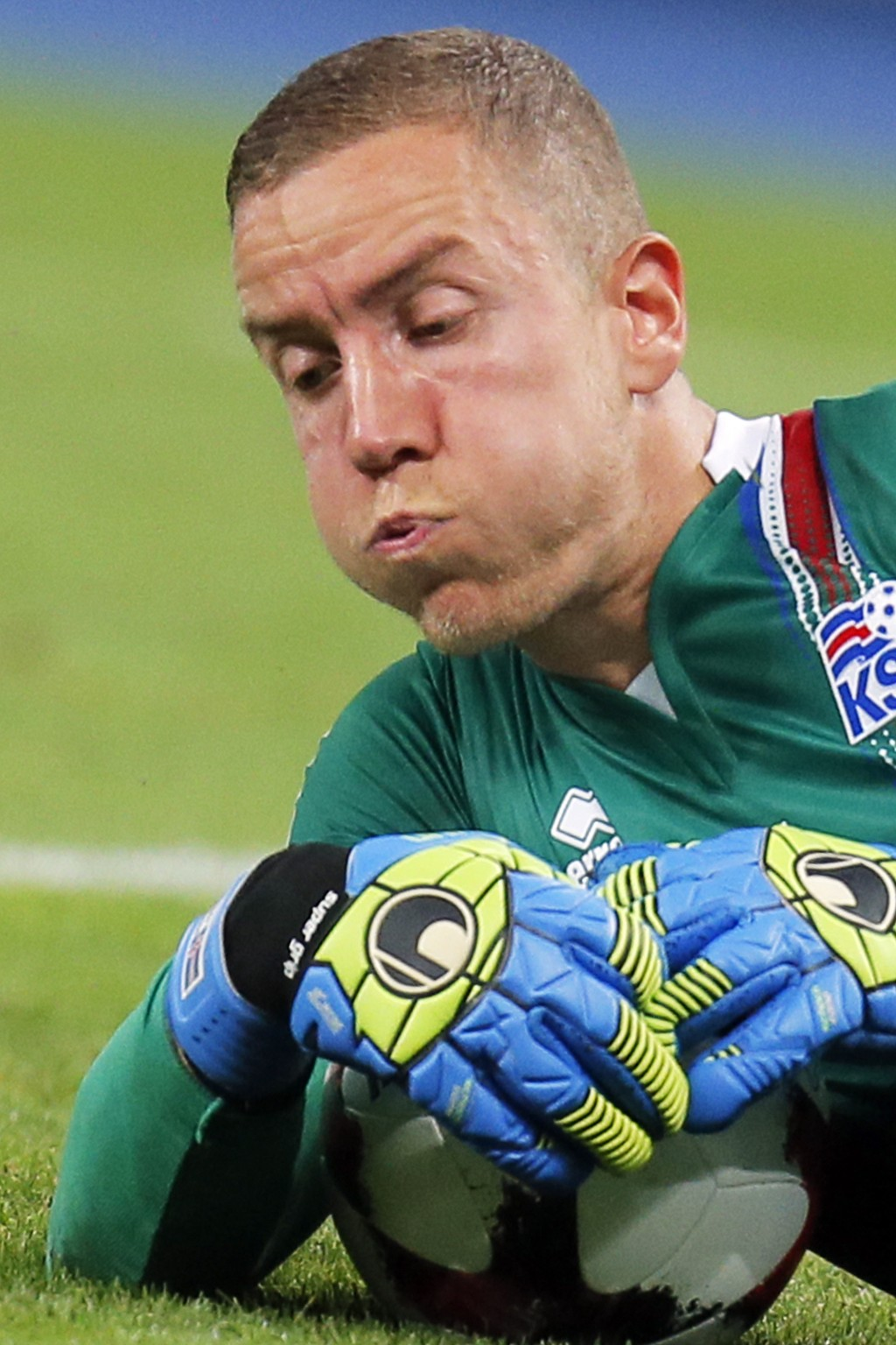 FILE - In this Monday, Sept. 5, 2016 filer , Iceland goalkeeper Hannes Halldorsson covers the ball during World Cup Group I qualifying soccer match be...