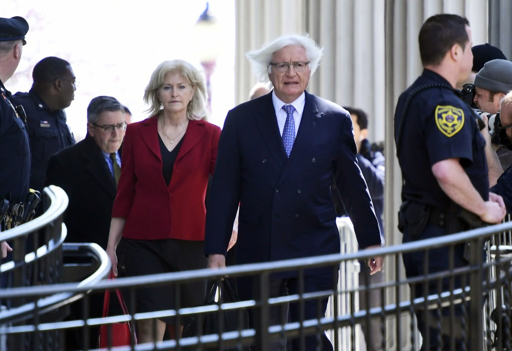 Bill Cosby's attorney Kathleen Bliss, left, and Tom Mesereau, right, leave the courthouse after their client was found guilty in his sexual assault re...