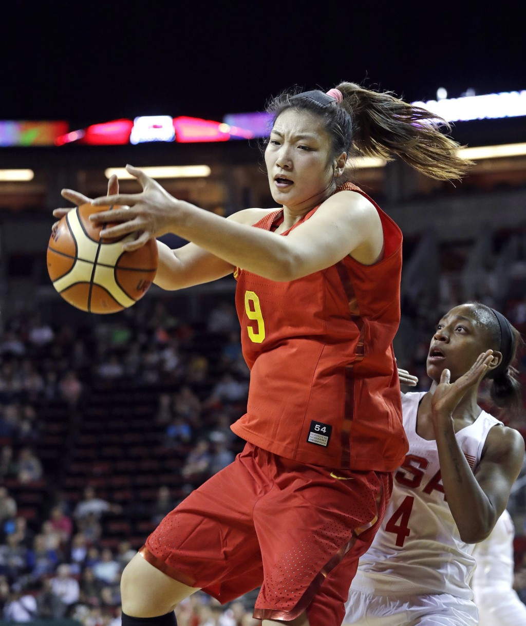 China's Meng Li (9) pulls down a rebound in front of United States' Jewell Loyd in the first half of an exhibition basketball game Thursday, April 26,...