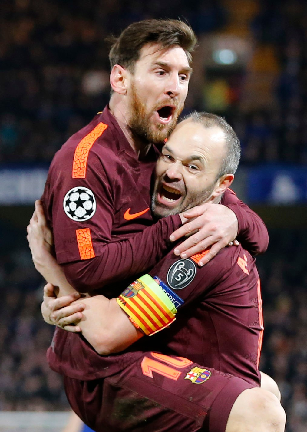FILE - In this Tuesday, Feb. 20, 2018 file photo Barcelona's Lionel Messi celebrates with Andres Iniesta scoring his side's first goal during a Champi...