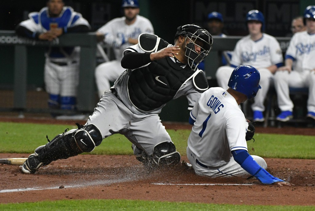 Kansas City Royals' Ryan Goins (1) is tagged out by Chicago White Sox catcher Welington Castillo (21) as he tries to score on a fielder's choice durin...