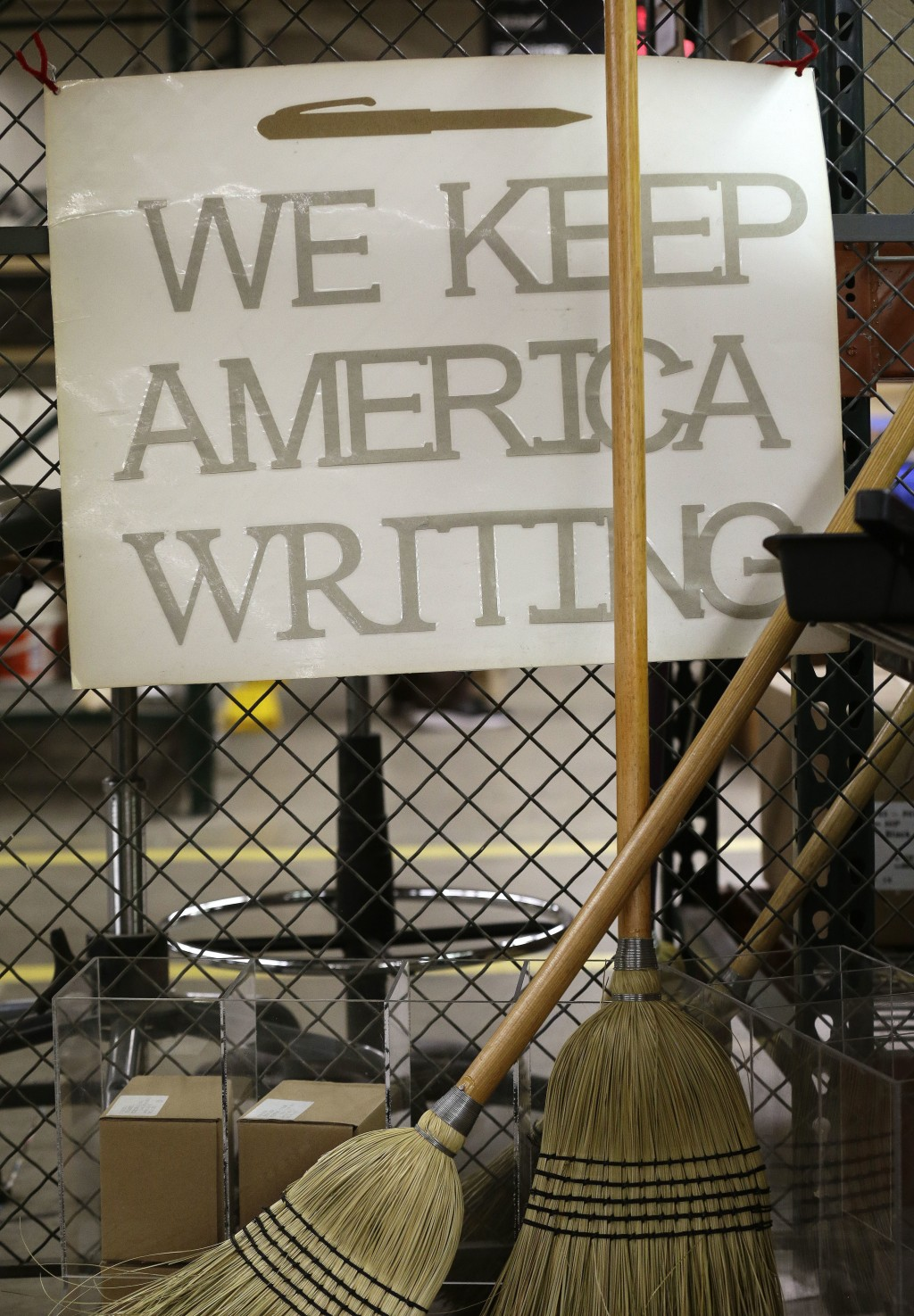 This Monday, April 16, 2018, photo shows a poster in the SKILCRAFT pen section at the Industries of the Blind in Greensboro, N.C. where pens are manuf...