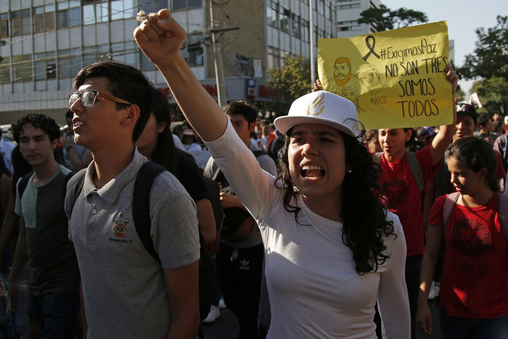 A student chants slogans to protest the murder of three film students who have become emblematic of Mexico's missing, in Guadalajara, Mexico, Thursday...