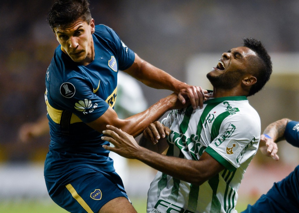 In this April 25, 2018 photo, Miguel Hernandez of Brazil's Palmeiras, right, runs into Santiago Vergini of Argentina's Boca Juniors during a Copa Libe...