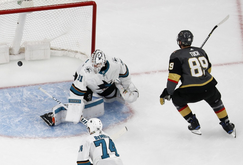 Vegas Golden Knights right wing Alex Tuch (89) scores against San Jose Sharks goaltender Martin Jones (31) during the first period of Game 1 of an NHL...