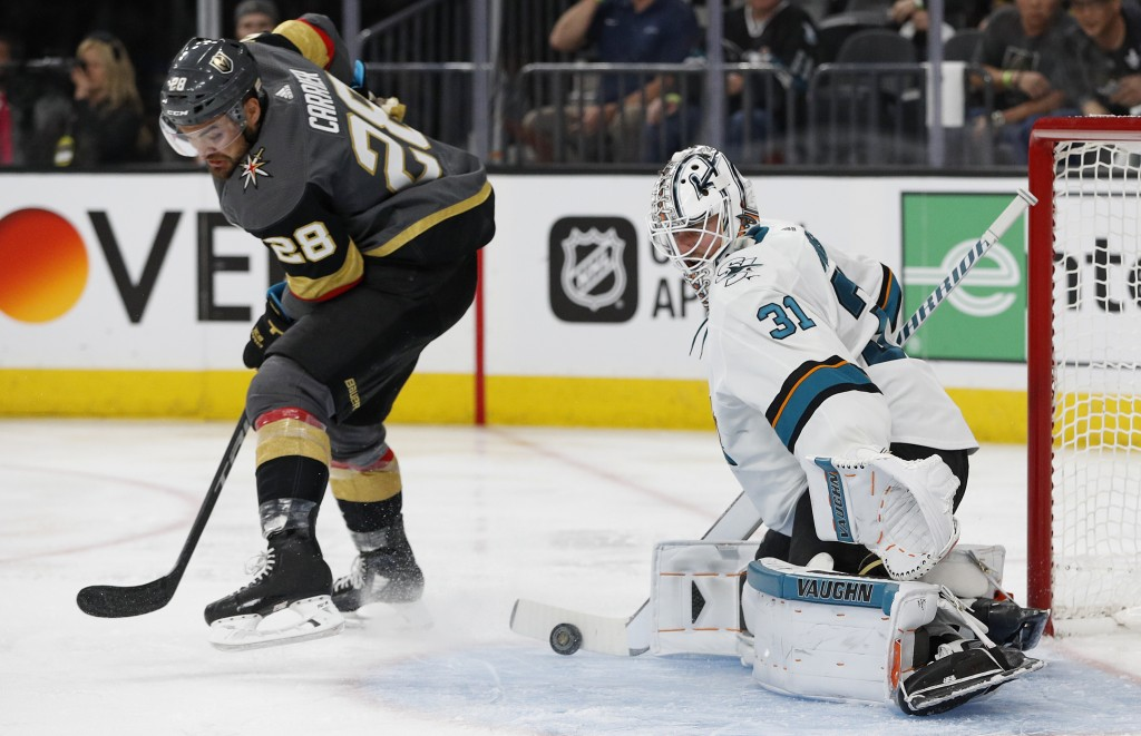 San Jose Sharks goaltender Martin Jones (31) blocks a shot by Vegas Golden Knights left wing William Carrier (28) during the second period of Game 1 o...