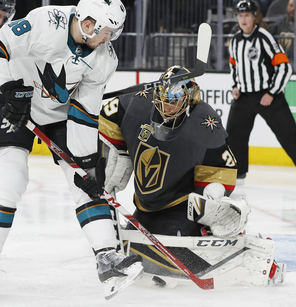 Vegas Golden Knights goaltender Marc-Andre Fleury (29) blocks a shot by San Jose Sharks center Tomas Hertl (48) during the third period of Game 1 of a...
