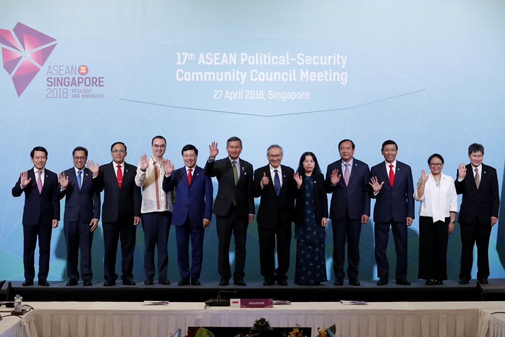 Foreign Ministers, and country representatives, left to right, Laos Minister of Foreign Affairs, Saleumxay Kommasith, unidentified official, Myanmar's...