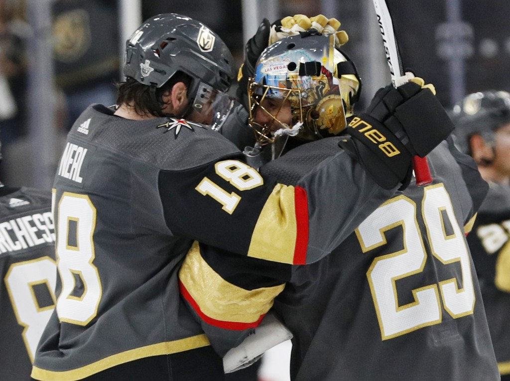Vegas Golden Knights goaltender Marc-Andre Fleury (29) celebrates with left wing James Neal after the Golden Knights defeated the San Jose Sharks 7-0 ...