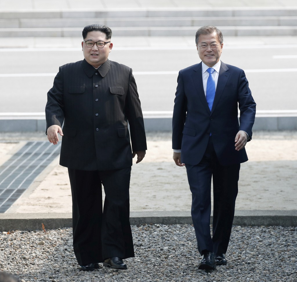 North Korean leader Kim Jong Un, left, walks with South Korean President Moon Jae-in at the border village of Panmunjom in the Demilitarized Zone, Sou...