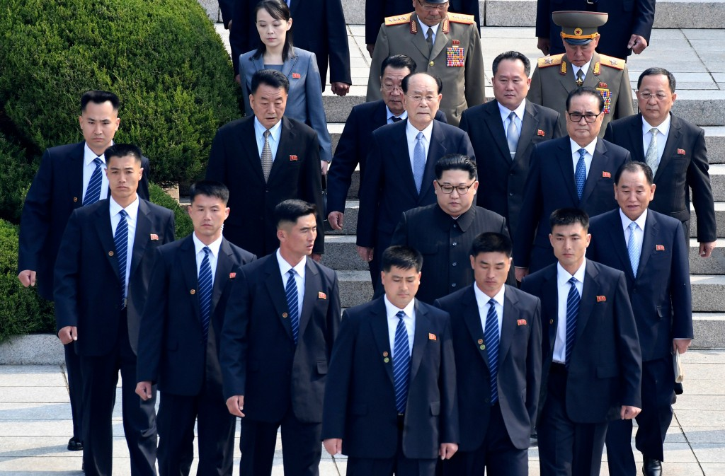 North Korean leader Kim Jong Un, center, is surrounded by his security guards upon his arrival for a meeting with South Korean President Moon Jae-in a...