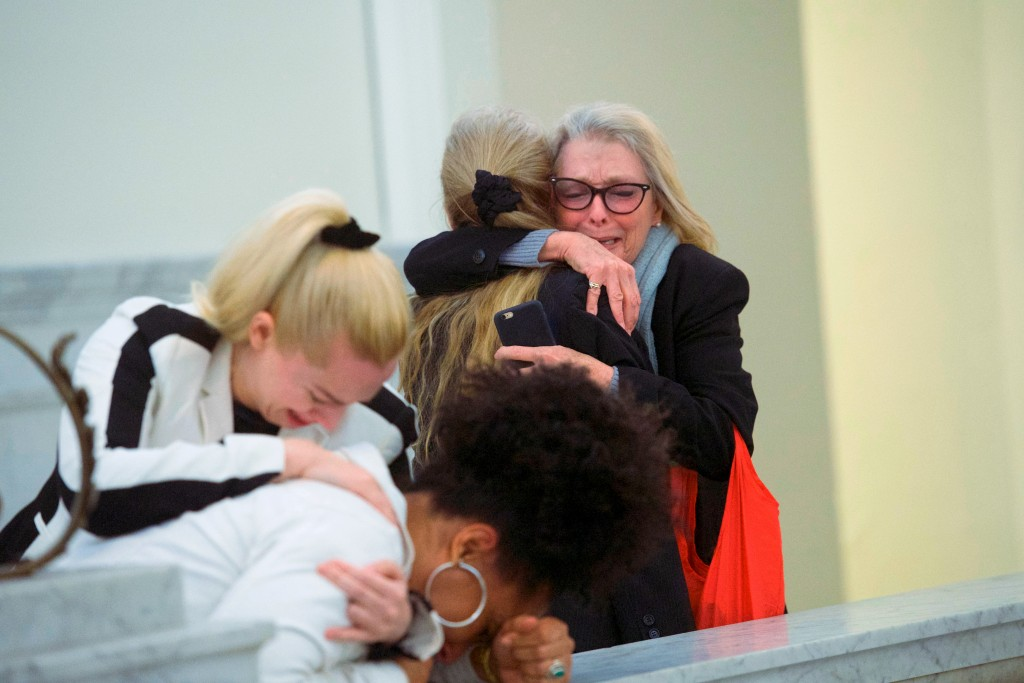 Accuser Lili Bernard, foreground, is consoled by grief counselor Caroline Heldman left, as accuser Victoria Valentino, right, is comforted outside the...