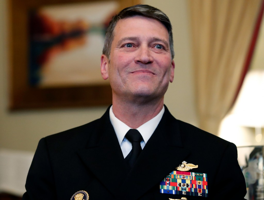 FILE - In this April 16, 2018, file photo, U.S. Navy Rear Adm. Ronny Jackson, M.D., left, sits with Sen. Johnny Isakson, R-Ga., chairman of the Vetera...