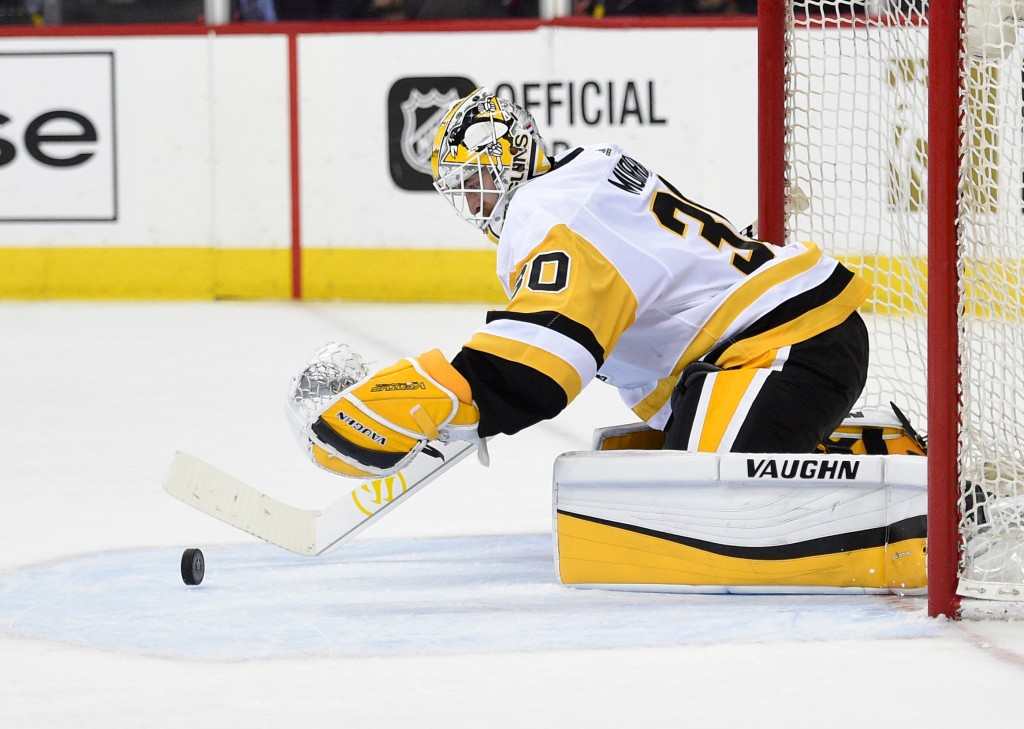 Pittsburgh Penguins goaltender Matt Murray reaches for the puck during the second period in Game 1 of an NHL second-round hockey playoff series agains...