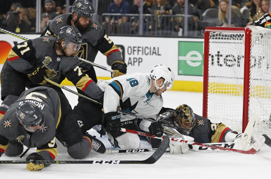Vegas Golden Knights goaltender Marc-Andre Fleury makes a save beside San Jose Sharks center Tomas Hertl (48) during the first period of Game 1 of an ...