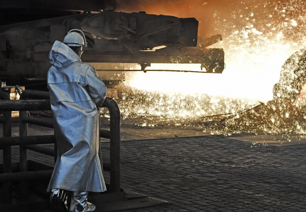 A steel worker watches the hot metal at the Thyssenkrupp steel factory in Duisburg, Germany, Friday, April 27, 2018. Duisburg is the biggest steel pro...