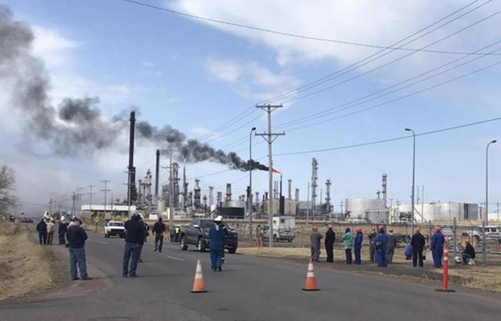 This photo provided by KQDS_FOX21 in Duluth, Minn., shows personnel outside the Husky Energy oil refinery Thursday morning, April 26, 2018, after a ta...