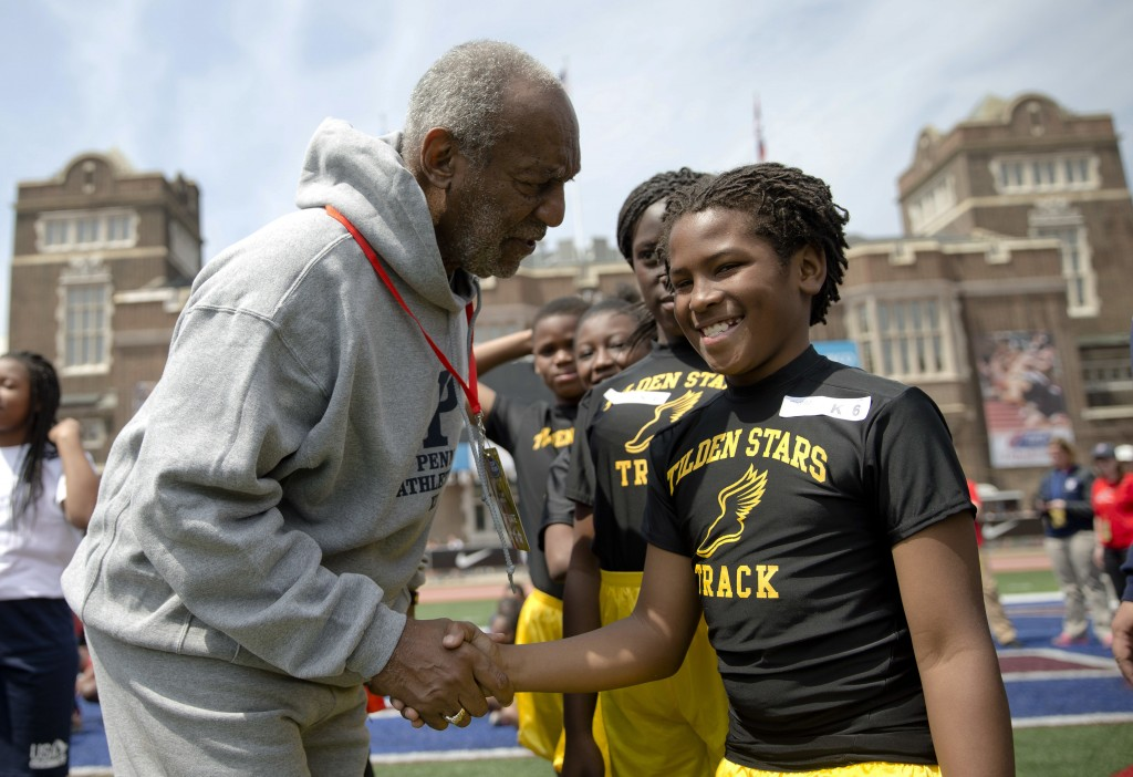 FILE - In this April 25, 2014 file photo, entertainer Bill Cosby meets with young athletes during the Penn Relays athletics meet in Philadelphia. On T...