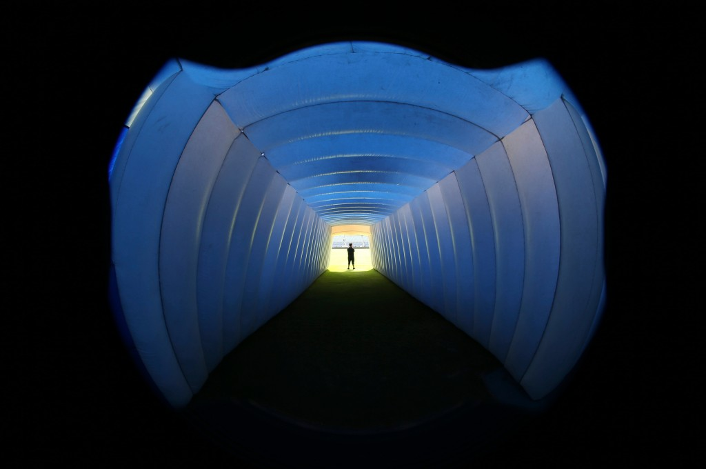 In this April 21, 2018 photo, an inflatable tunnel is illuminated blue before Cruz Azul players go to the field for their Mexico league soccer match w...