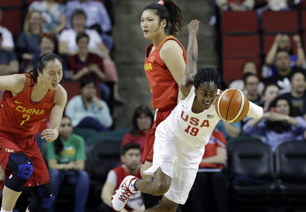 United States' Tiffany Hayes (19) races away from China's Ting Shao (7) and Meng Li after stealing the ball during the first half of an exhibition bas...