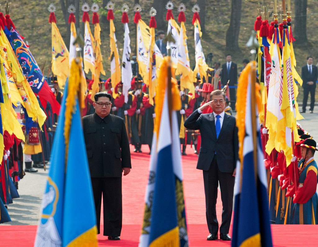 North Korean leader Kim Jong Un, left, and South Korean President Moon Jae-in inspect an honor guard after Kim crossed the border into South Korea for...