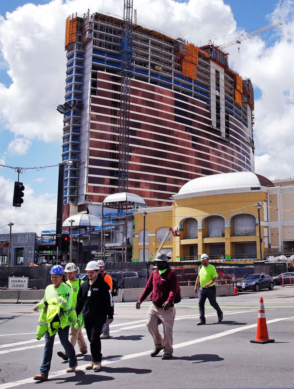 Construction workers leave at the end of their shift at the Wynn Resorts casino site in Everett, Mass., Thursday, April 26, 2018. Massachusetts gambli...