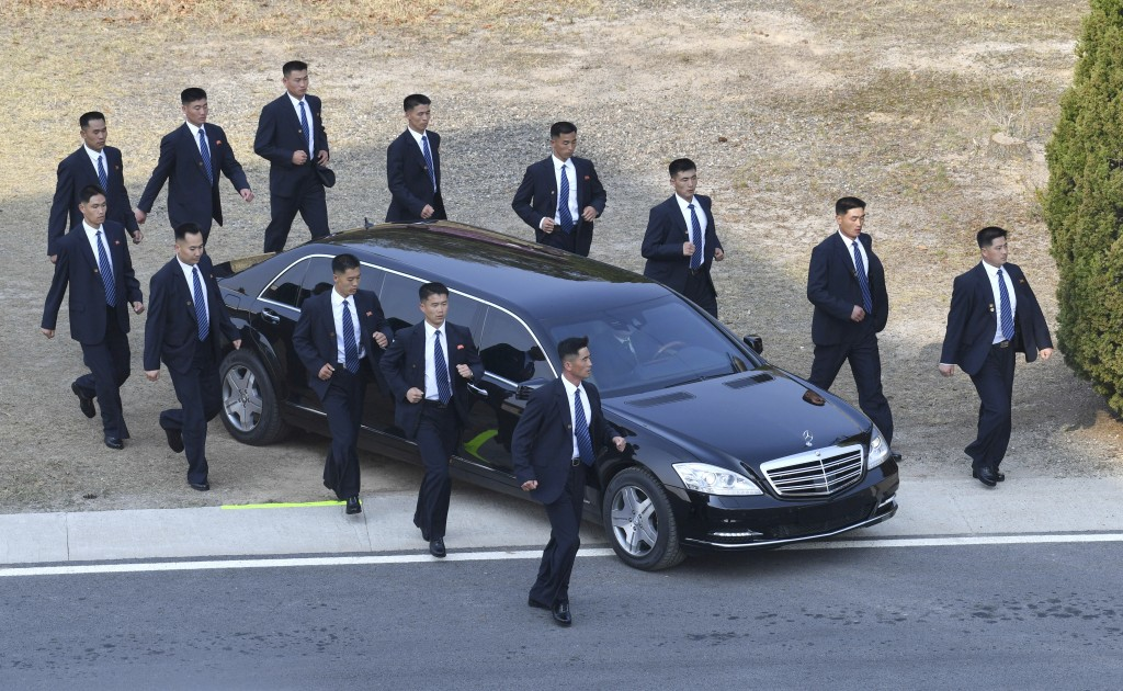 North Korean security persons run by a car carrying North Korean leader Kim Jong Un as the car arrived for planting pine tree with South Korean Presid...