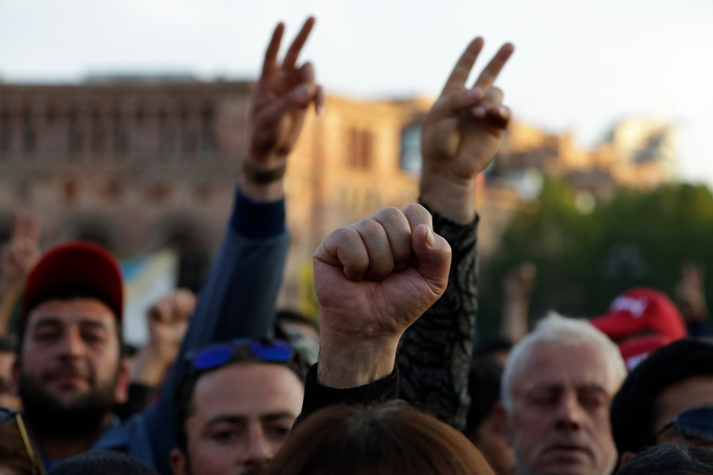 Protesters react listening to their leader Nikol Pashinian at Republic Square in Yerevan, Armenia, Thursday, April 26, 2018. The Armenian parliament o...