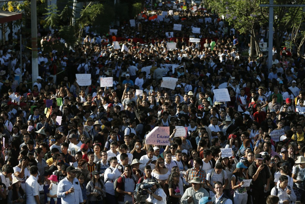 People protest the murder of three film students who have become emblematic of Mexico's missing, in Guadalajara, Mexico, Thursday, Jan. 26, 2018. Pros...