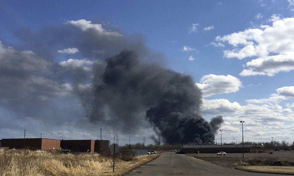 A fire at the Husky Energy oil refinery in Superior, Wis., seen from a police check point in Superior, Wis., on Thursday, April 26, 2018, rocked the r...
