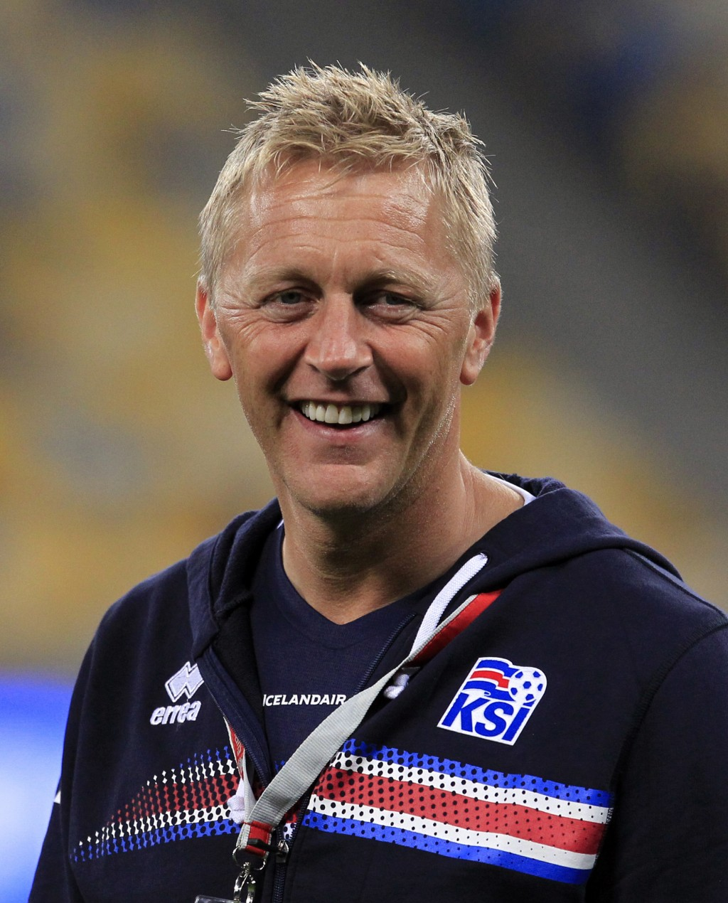 FILE - In this Monday, Sept. 5, 2016 filer, Iceland coach Heimir Hallgrimsson smiles prior to the World Cup Group I qualifying soccer match between Uk...