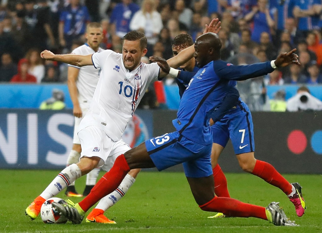 FILE - In this Sunday, July 3, 2016 file photo, Iceland's Gylfi Sigurdsson, left, and France's Eliaquim Mangala challenge for the ball during the Euro...